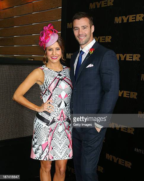 Lauren Phillips and Kris Smith at the Myer marquee on Emirates Stakes Day at Flemington Racecourse on November 9 2013 in Melbourne Australia