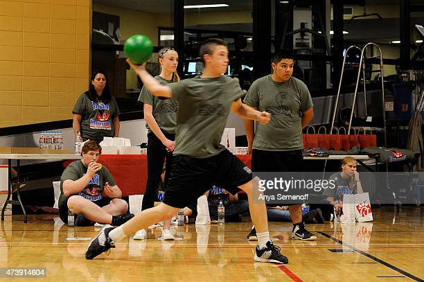 Lauren Phillips back left and Jaydyn Romero back right watch from the sidelines as teammate Zach Lay throws a ball during a dodgeball tournament at...