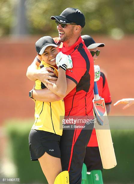 Lauren Phillips is hugged by Kris Smith after she was dismissed while batting during the Medibank Melbourne Celebrity Twenty20 match at North Port...