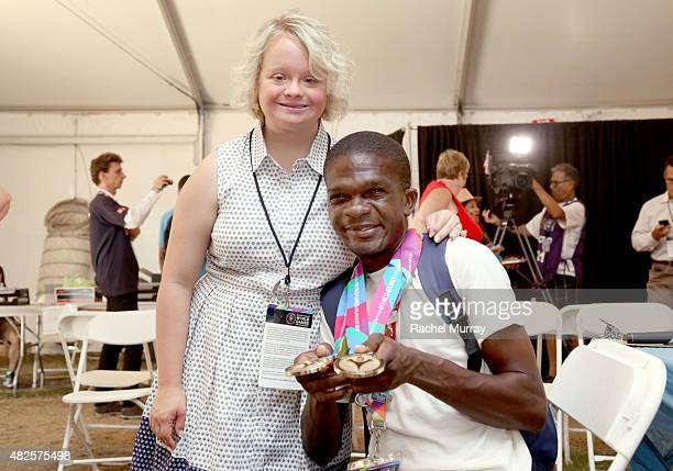 Lauren Potter visits with Special Olympics Athlete Tyson Browne during a testing at The Starkey Hearing Foundation Healthy Hearing Clinic at USC on...