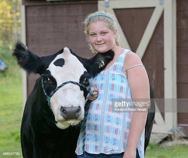 Lauren Pride with her 3 year old beef cow Grace at her farm in Limington