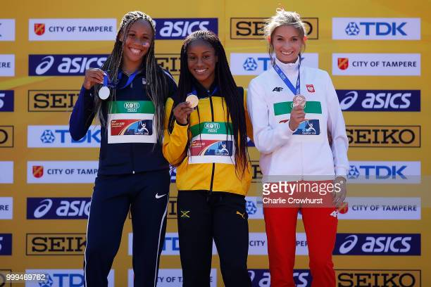 Lauren Rain Williams of The USA Brianna Williams of Jamaica and Martyna Kotwila of Poland celebrate with their medals during the medal ceremony for...