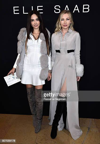 Lauren Remington Platt and a guest attend the Elie Saab Spring Summer 2016 show as part of Paris Fashion Week on January 27 2016 in Paris France