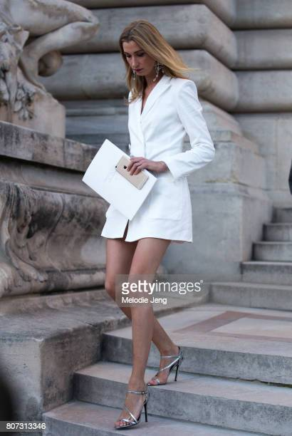Lauren Remington Platt wears a white dress outside the Giambattista Valli show on July 3 2017 in Paris France