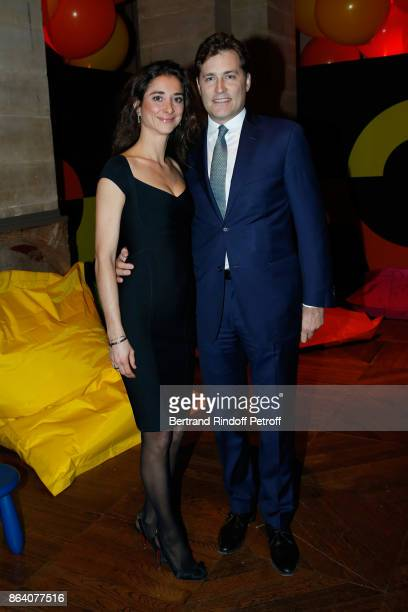 Lauren Ricard and her husband Gregoire Scholler attend the 'Bal Jaune Elastique 2017' Dinner Party at Palais Brongniart during FIAC on October 20...