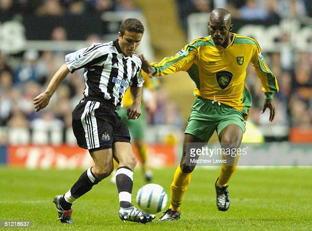 Lauren Robert of Newcastle holds off Damien Francis of Norwich during the FA Barclays Premiership match between Newcastle United and Norwich City at...