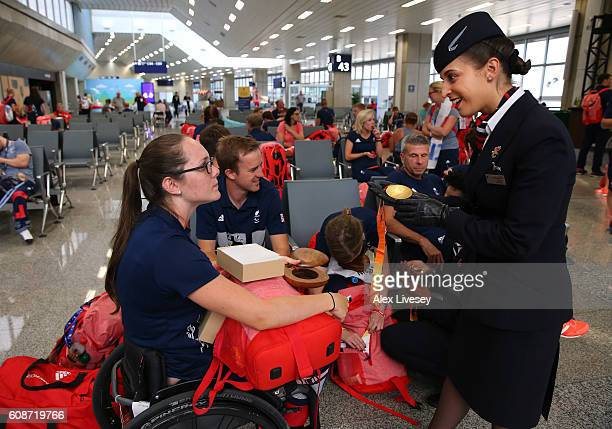 Lauren Rowles of the Paralympics GB Team shows her medals to members of the British Airways cabin crew prior to the flight back from Galeao Airport...