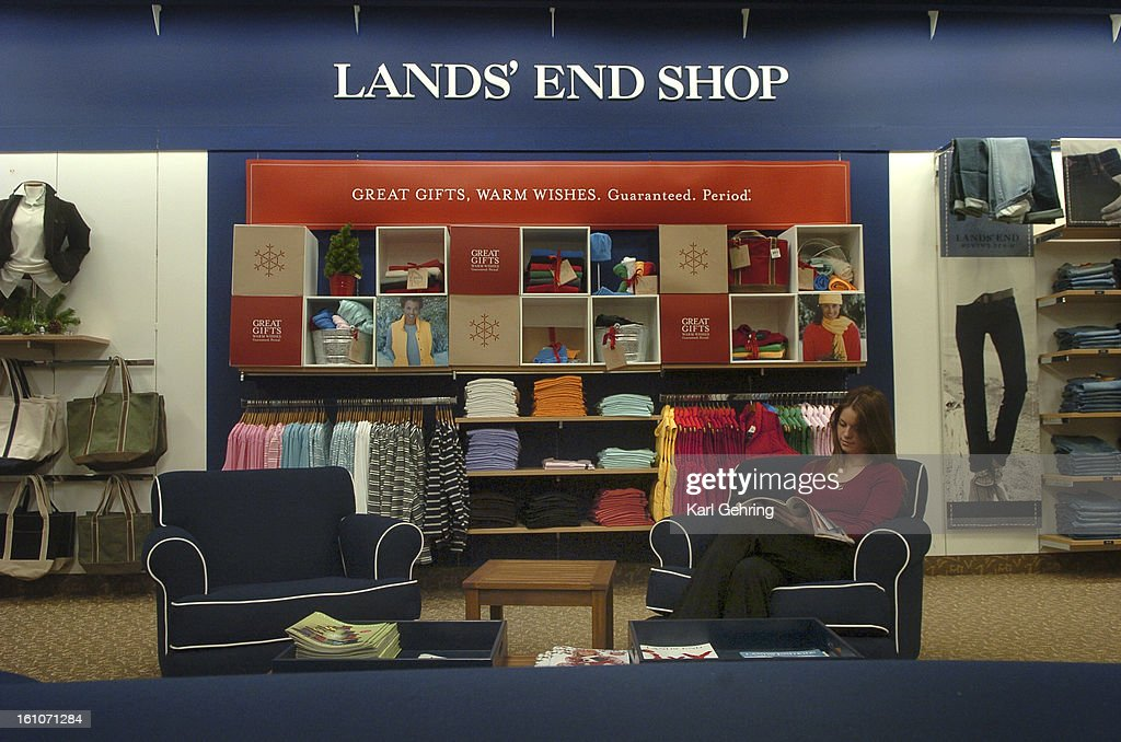 (KG) LANDSEND -- Lauren Saenz browsed through a catalog in one of the store's customer lounge areas. The new Lands' End shop in Sears takes almost the entire main floor, featuring a variety of categories of apparel and home products. The Denver Post/ Karl : News Photo