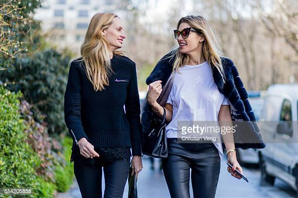 Lauren Santo Domingo and Australian model Jessica Hart wearing a fur jacket and a black Gucci bag and white tshirt with star print outside...