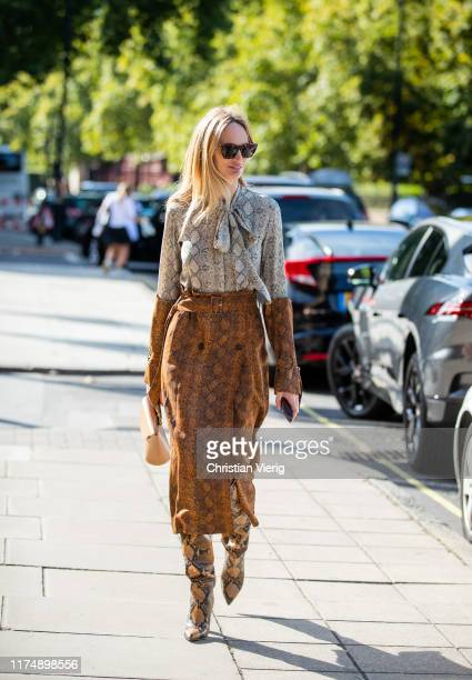 Lauren Santo Domingo is seen wearing grey and brown button shirt and skirt with snake print outside Emilia Wickstead during London Fashion Week...