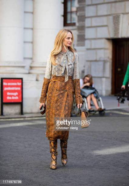 Lauren Santo Domingo wearing brown grey skirt and top with snake print boots is seen outside Victoria Beckham during London Fashion Week September...