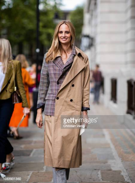 Lauren Santo Domingo wearing mix of checked blazer and trench coat is seen outside ALEXACHUNG during London Fashion Week September 2018 on September...