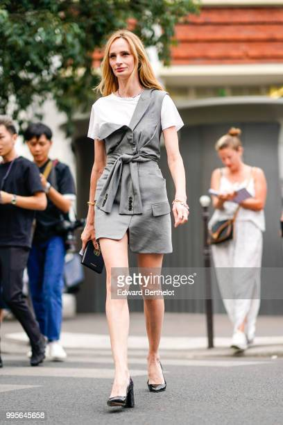 Lauren Santo Domingo wears a gray dress, a white t-shirt, a knot, black shoes , outside Givenchy, during Paris Fashion Week Haute Couture Fall Winter...