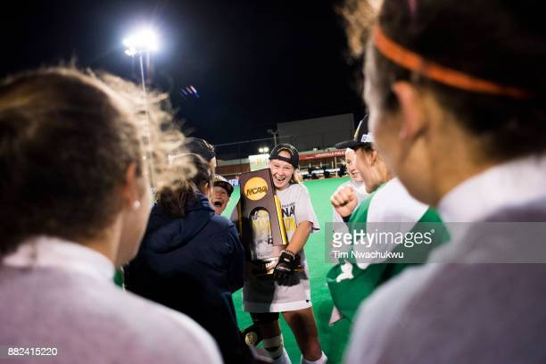 Lauren Schweppe of Middlebury College is congratulated by teammates after being name the tournament Most Outstanding Player during the Division III...
