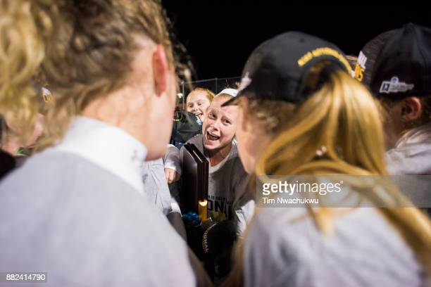 Lauren Schweppe of Middlebury College laughs with teammates following the Division III Women's Field Hockey Championship held at Trager Stadium on...