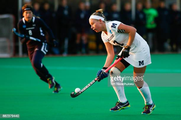 Lauren Schweppe of Middlebury College looks for an open teammate during the Division III Women's Field Hockey Championship held at Trager Stadium on...