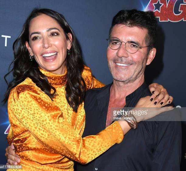 Lauren Silverman and Simon Cowell arrives at the America's Got Talent Season 14 Live Show Red Carpet at Dolby Theatre on September 17 2019 in...