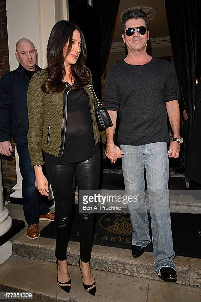 Lauren Silverman and Simon Cowell attend as Cheryl Cole announces her return to the X Factor judging panel on March 11 2014 in London England