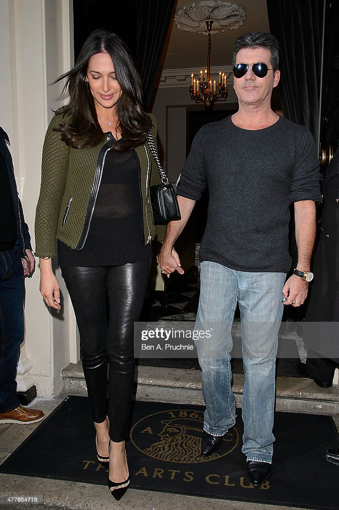 Lauren Silverman and Simon Cowell attend as Cheryl Cole announces her return to the X Factor judging panel on March 11, 2014 in London, England.