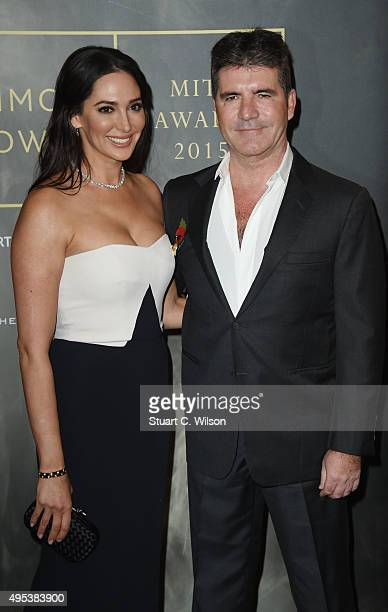 Lauren Silverman and Simon Cowell attend the Music Industry Trust Awards at The Grosvenor House Hotel on November 2 2015 in London England