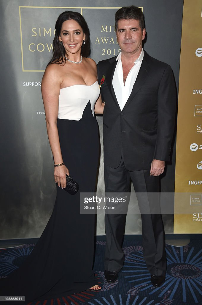 Lauren Silverman and Simon Cowell attend the Music Industry Trust Awards at The Grosvenor House Hotel on November 2, 2015 in London, England.