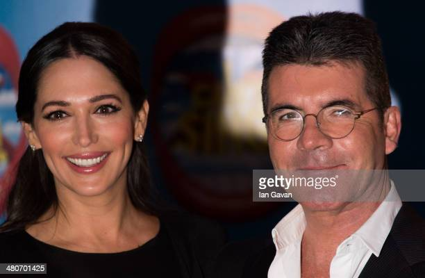 Lauren Silverman and Simon Cowell attend the press night of I Can't Sing The X Factor Musical at London Palladium on March 26 2014 in London England