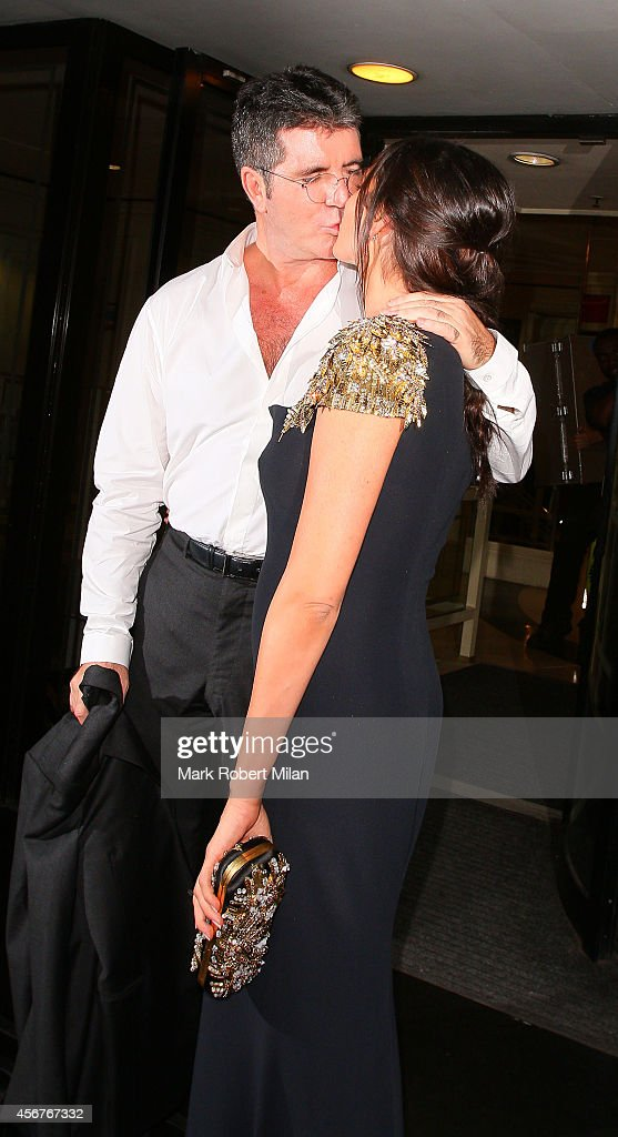 Lauren Silverman and Simon Cowell attend the Pride of Britain awards at The Grosvenor House Hotel on October 6, 2014 in London, England.