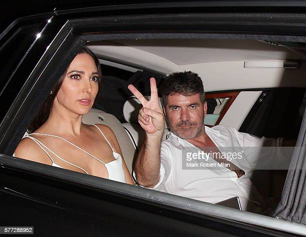 Lauren Silverman and Simon Cowell leaving the Syco summer party at St James' Palace on July 18 2016 in London England