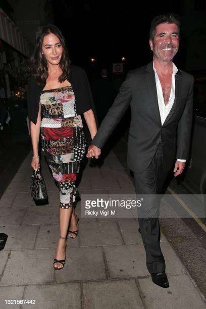 Lauren Silverman and Simon Cowell seen enjoying dinner with Richard Desmond and wife Joy Canfield at Harry's Bar on June 03, 2021 in London, England.
