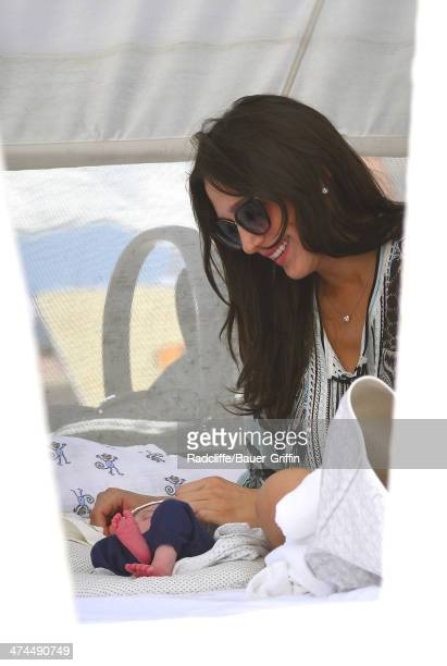 Lauren Silverman is seen with her 9 day old newborn baby Eric Cowell at the beach on February 23 2014 in Miami Florida