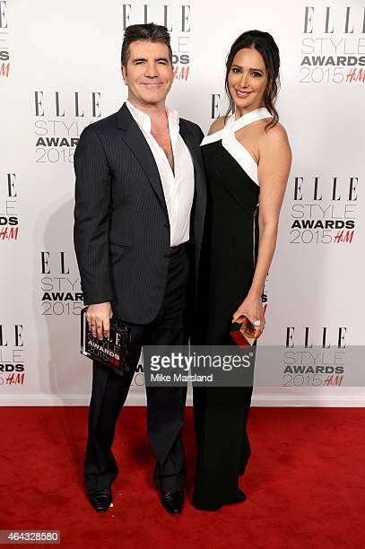 Lauren Silverman poses with Simon Cowell winner of the Outstanding Contribution to Entertainment Award in the winners room during the Elle Style...