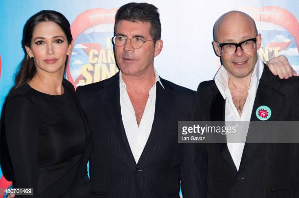Lauren silverman Simon Cowell and Harry Hill attends the press night of 'I Can't Sing The X Factor Musical' at London Palladium on March 26 2014 in...