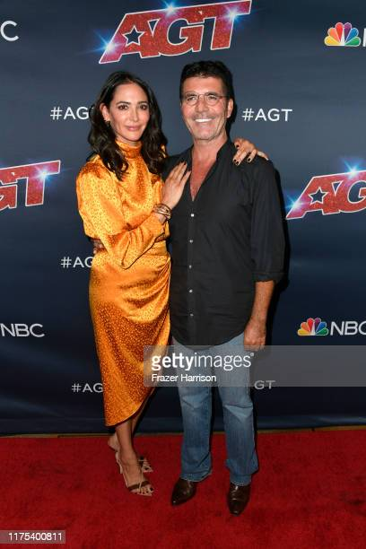 Lauren Silverman Simon Cowell attend America's Got Talent Season 14 Live Show Red Carpet at Dolby Theatre on September 17 2019 in Hollywood California