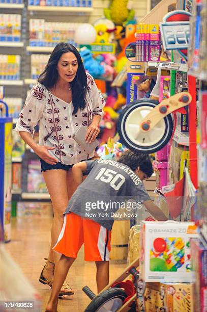 Lauren Silverman wife of real estate mogul Andrew Silverman shops for toys with her son Adam at Second Star Toys on Saturday August 3 2013 in...