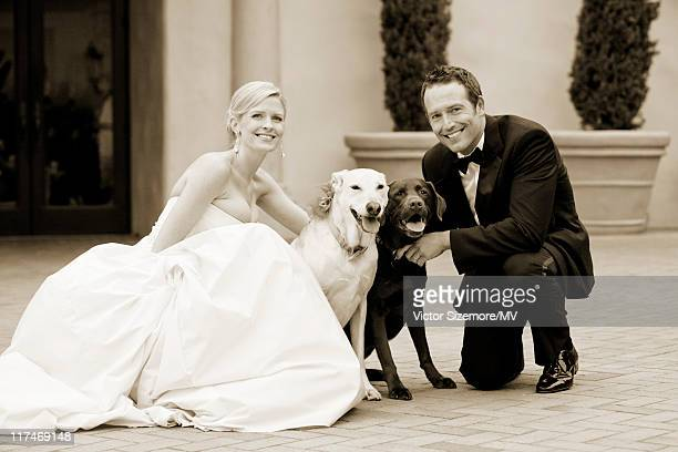 Lauren Skaar and Michael Vartan pose with their dogs Millie and Lucy after their wedding ceremony at The Resort at Pelican Hill April 2 2011 in...