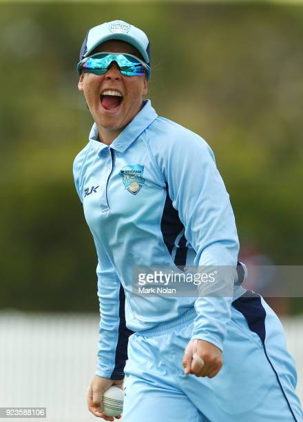 Lauren Smith of NSW celebrates taking a catch during the WNCL Final match between New South Wales and Western Australia at Blacktown International...