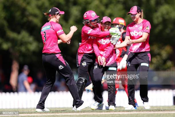Lauren Smith of Sydney Sixers celebrates a wicket with Ellyse Perry Alyssa Healy and Sarah Aley during the Women's Big Bash League match between the...