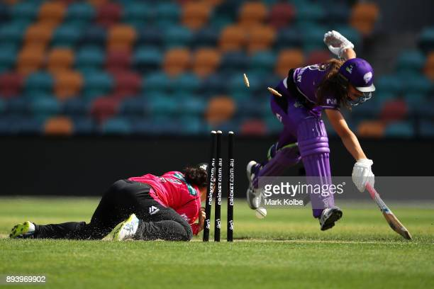 Lauren Smith of the Sixers attempts to run out Erin Fazackerley of the Hurricanes during the Women's Big Bash League match between the Hobart...