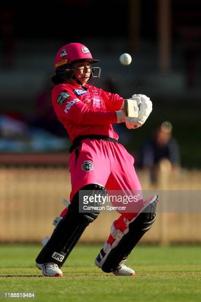 Lauren Smith of the Sixers bats during the Women's Big Bash League match between the Hobart Hurricanes and the Sydney Sixers at North Sydney Oval on...