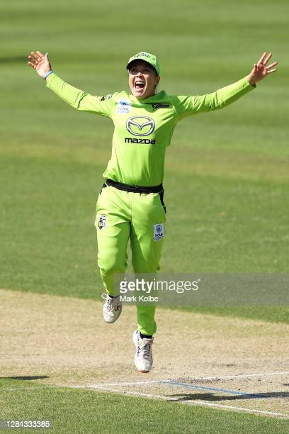 Lauren Smith of the Thunder celebrates taking the wicket of Amy Satterthwaite of the Renegades during the Women's Big Bash League WBBL match between...
