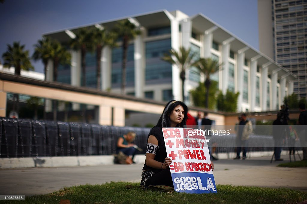 Lauren Soorani demonstrates at the annual shareholder meeting of News Corp at Fox Studios October 21, 2011 in Century City, California. Protesters are demonstrating against Fox and News Corp's for what they see as one-sided reporting practices.