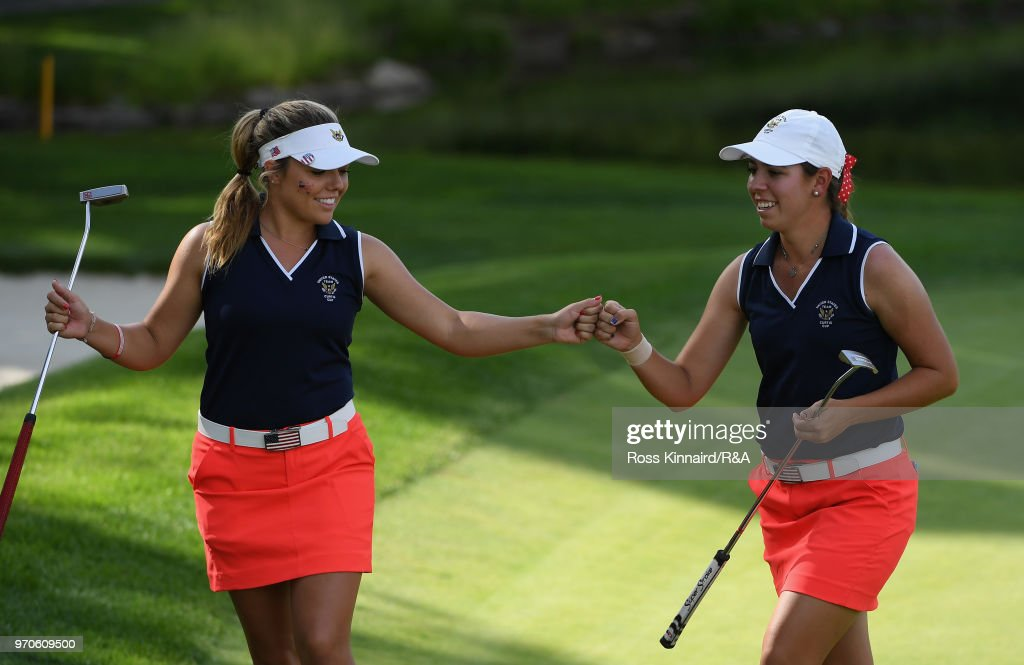 Lauren Stephenson and Kristen Gillman of the United States team celebrate on the fifth green in their match against Annabell Fuller and India Clyburn of the Great Britain and Ireland team during the afternoon foursome matches on day two of the 2018 Curtis Cup Match at Quaker Ridge Golf Club on June 9, 2018 in Scarsdale, New York.