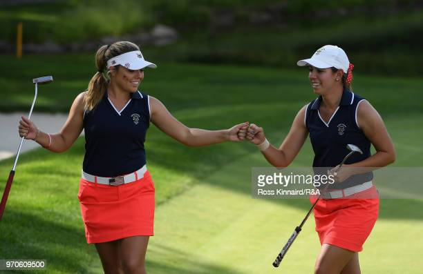 Lauren Stephenson and Kristen Gillman of the United States team celebrate on the fifth green in their match against Annabell Fuller and India Clyburn...