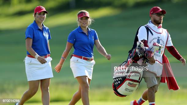 Lauren Stephenson of the United States Team walks with Kristen Gillman on the 11th hole in their match against Paula Grant and Lily May Humphreys of...