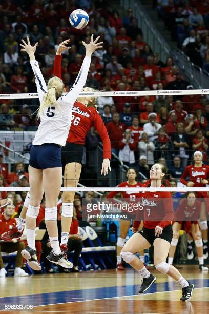 Lauren Stivrins of the University of Nebraska taps the ball past Ali Frantti of Penn State University during the Division I Women's Volleyball...