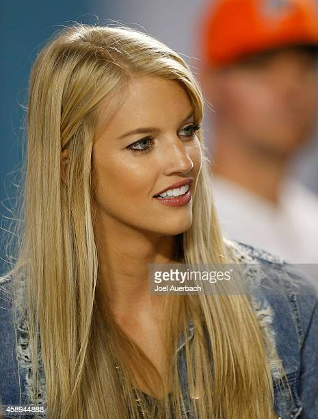 Lauren Tannehill wife of quarterback Ryan Tannehill of the Miami Dolphins is shown on the sidelines before the Dolphins met the Buffalo Bills in a...