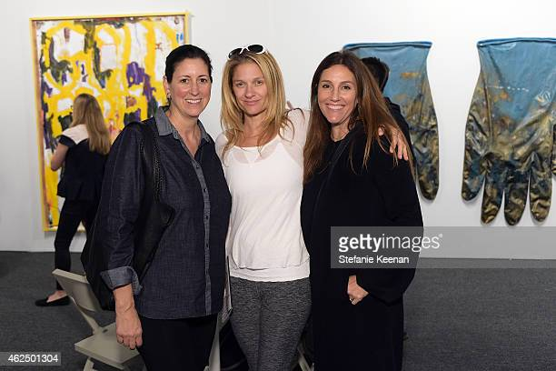 Lauren Taschen Elizabeth Guber and Brooke Glassman attend the Art Los Angeles Contemporary 2015 Opening Night at Barker Hangar on January 29 2015 in...
