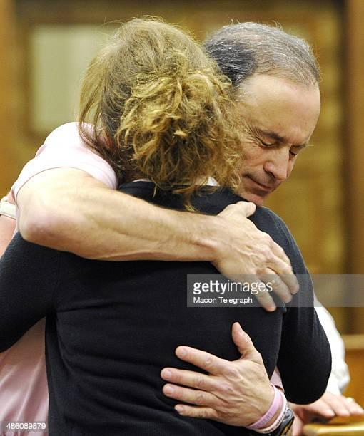 Lauren Teresa Giddings' boyfriend David Vandiver embraces Karen Giddings in the courtroom before Stephen McDaniel plead guilty in court Monday morning