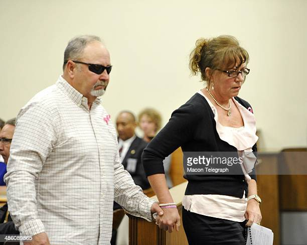 Lauren Teresa Giddings' father and mother Billy and Karen Giddings walk back to their seat in the courtroom gallery after reading her victim's...