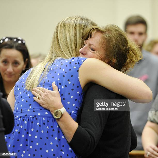 Lauren Teresa Giddings' mother Karen Giddings hugs Lauren's friend Lori Supsic in the courtroom after Stephen McDaniel plead guilty in court Monday...